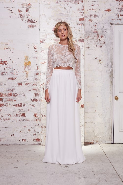 We love the crop top look for Miley! This Karen Willis Holmes top and skirt combo is the perfect balance of bridal and boho.