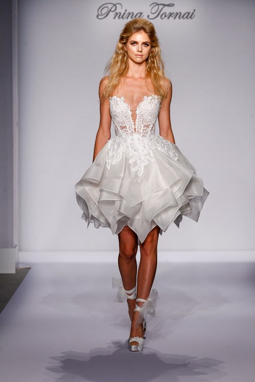 Who better to wear a cocktail-length wedding dress? This Pnina Tornai with a deep sweetheart neck and see-through bodice would be perfect.